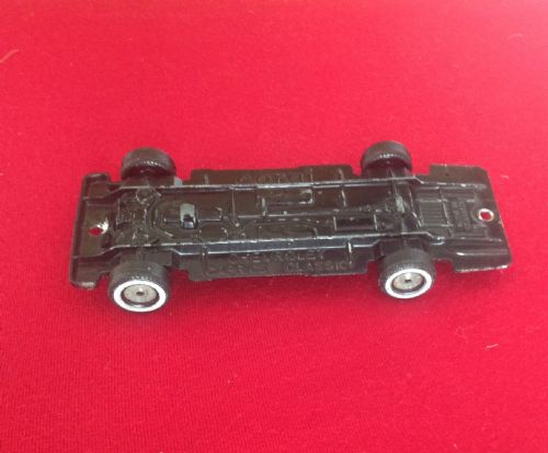 Corgi #326 - Original - Chevrolet Caprice Police Car Baseplate with wheels and axles